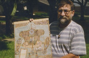 Dennis Holding an original Dellschau drawing of an Aero. PHOTO CREDIT: Pete Navarro, SOURCE Secrets of Dellschau (C) 2009.