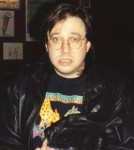 Bill_Hicks_at_the_Laff_Stop_in_Austin,_Texas,_1991_(2)_cropped CREDIT derivative work RanZag SOURCE Wikipedia Commons public Domain