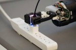 robot can grasp a freely hanging USB cable and plug it into a USB port.